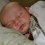 Liam sleeping in boppy
