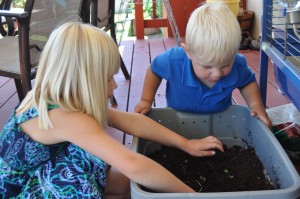 Bella and Noah with compost