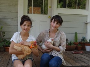 backyard chicken with girls