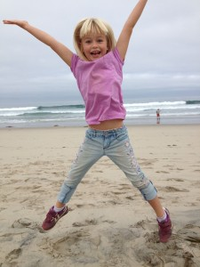 Bella jump on beach