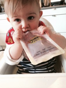 Liam eating from yummi pouch