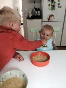 Noah feeding Liam