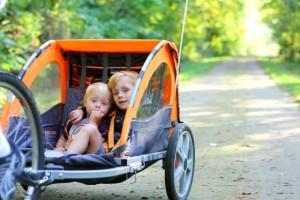 two kids in bike trailer